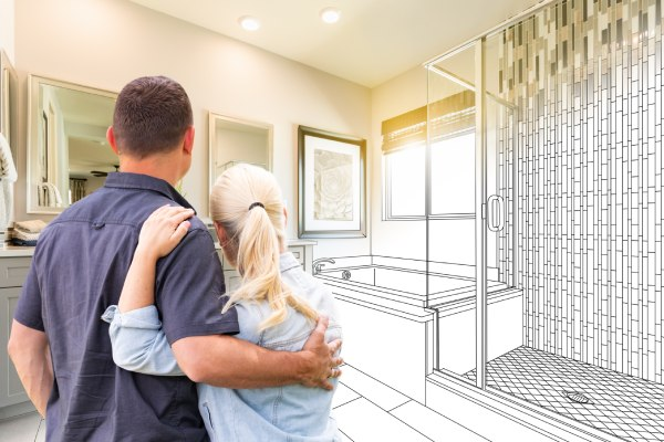 a couple looking at bathroom design